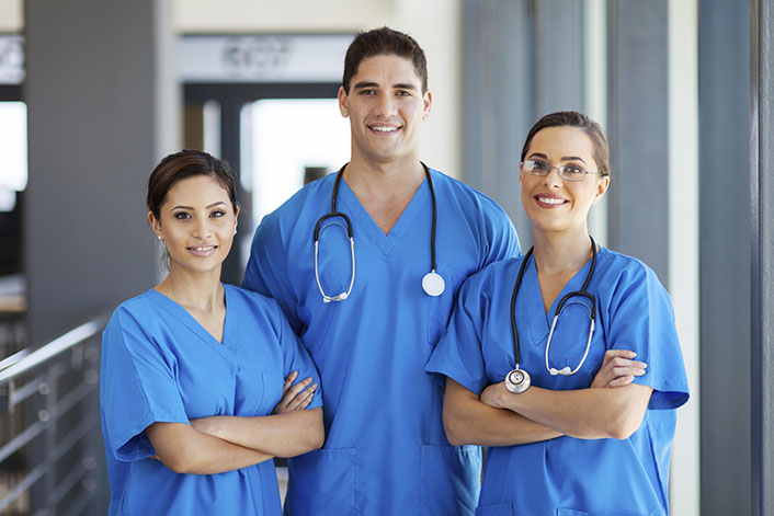 young hospital workers in scrubs